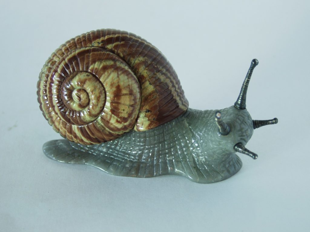 Gemstone carving work Snail by stone carver artist Dmitriy Emelyanenko