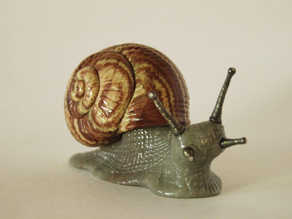 Stone carving work Snail by stone cutter artist Dmitriy Emelyanenko