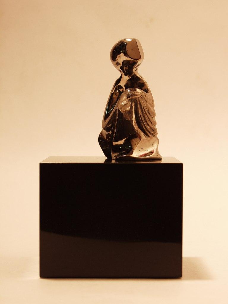 Pyrite carving artwork Expectation by stone carver Dmitriy Emelyanenko